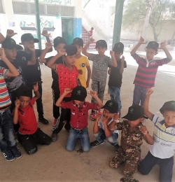 AMC distributed a number of school bags in the Jordan Valley schools